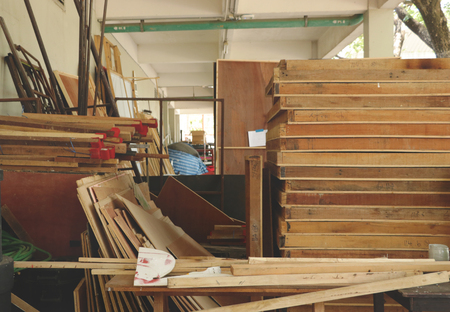 Piles of Rustic Wooden Frames in Messy Old Storehouse - Vintage Junkyard/ Garage/ Storeroom Archivio Fotografico
