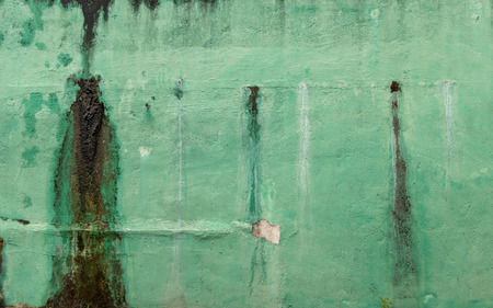 Vintage Old Moldy Green Wall - Painted Concrete Texture Peeled Paint