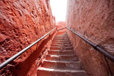 Climb the stairs in Saint Catalina, Arequipa, Peru