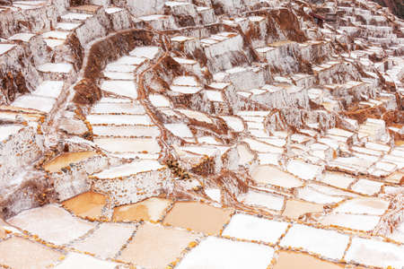 Salt fumes of Salineras ponds in Maras, Peru, Latin America. On the terraces there are more than 3,000 ponds, salt has been collected here since the time of the Inca Empire