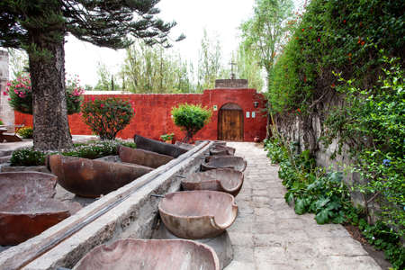 The inner garden of the monastery of Santa Catalina, Arequipa, Peru, a fountain of large clay pots, divided into two halves Stock Photo