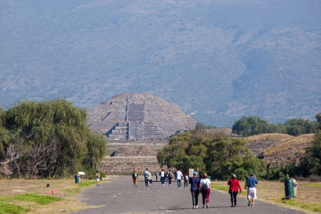 2019-11-25 Teotihuacan, Mexico. View of the pyramid of the moon, tourists walk.