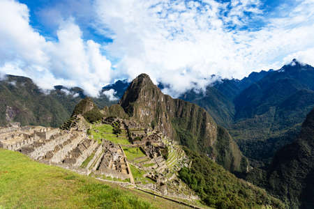 Classic view of Machu Picchu, Peru, UNESCO World Heritage Site, wide angle. Фото со стока