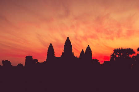 Ancient temple complex Angkor Wat at dawn, silhouette. Toning.