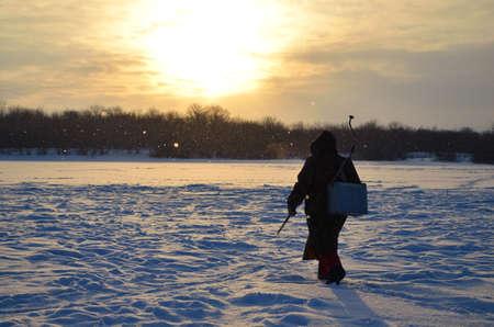 coming winter fisherman Stock Photo - 17343862
