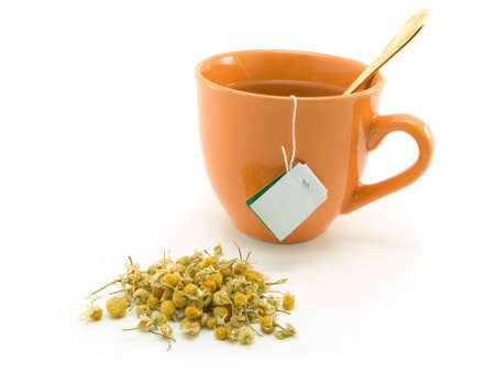 loose skin: Herbal tea and  chamomile on white background Stock Photo