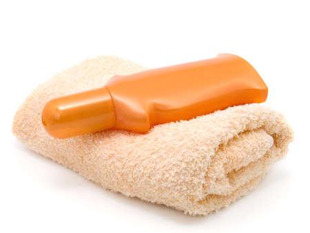 anti-sun cream and bath towel