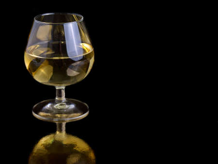 room for text: one glass white wine on black background, with room for text.