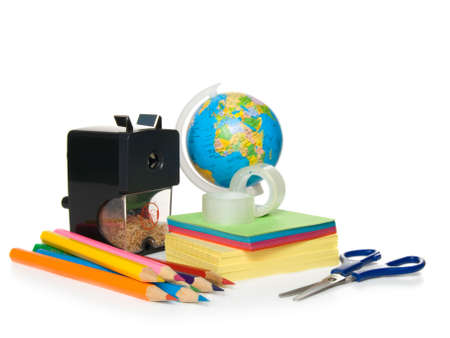 school tools: notebook, globe, pencil, knife-sharpener, sticky tape, scissors photo