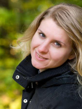 portrait of Beautiful romantic blonde in the autumn park  photo
