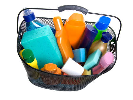 basket full of plastic bottle for lotion, shampoo, sunscreen etc in;  hygiene cleaners for housework. Isolated on white background. (A shopping)  photo