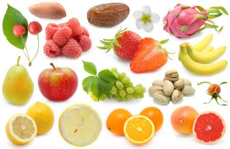 orange, dragon fruit, Lemon, grapes, raspberries, cherry, bananas, Strawberry, apple, nut, pear, pistachios, Stock Photo - 6295829