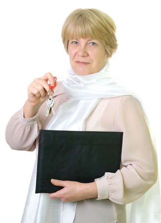 Mature business woman with folder and key of home. isolated on white background photo