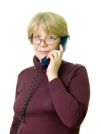 older person: a senior woman at telephone  Stock Photo