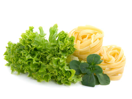 fresh salad, lettuce leaves and macaroni isolated on white background  Stock Photo - 6901288