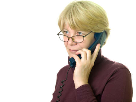 a senior woman at telephone  photo