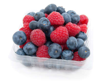 transparent basket with a raspberry and a blueberry on a white background  photo