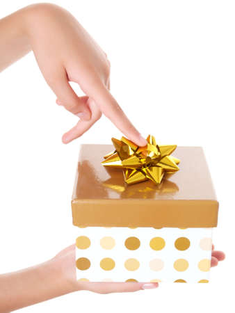 you are special: young girl with golden gift box for you  Stock Photo