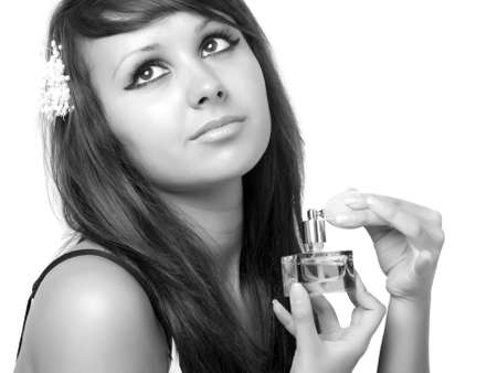 Young woman applying perfume on her neck. photo