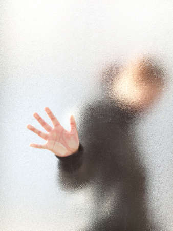 Silhouette of a girl  through frosted glass  Stock Photo
