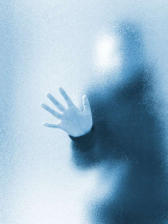 mysterious woman: Silhouette of a girl through frosted glass