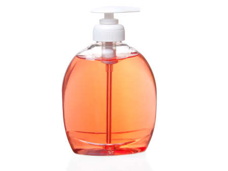 sanitizer: Plastic pump soap bottle without label on white