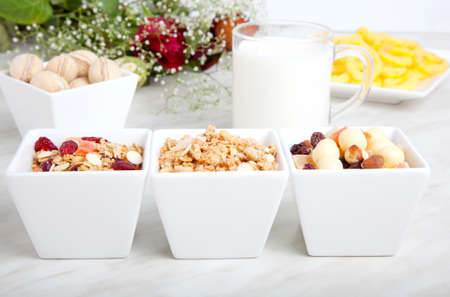 Breakfast of health food , product of muesli with dried fruit, nut, cornflakes and glass of milk  photo