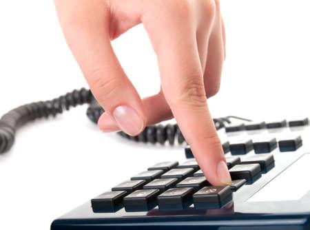 dialing: dedo presiona figura en un tel�fono  Foto de archivo
