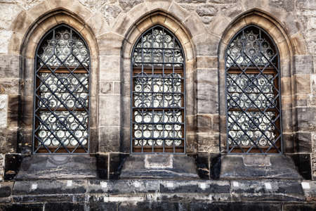 Old style windows on historic stone building photo