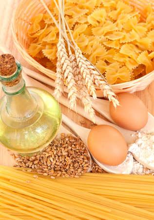 ingredients for homemade pasta. Food background: macaroni, spagetti, egg, flour, wheat, oil photo