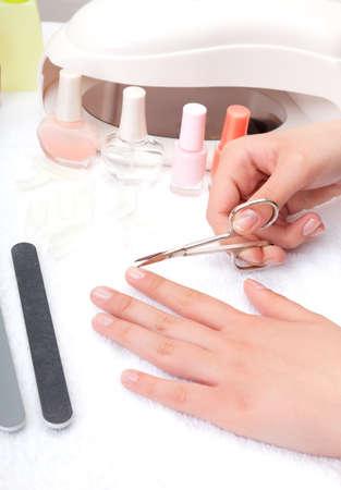 Teen cuts nails photo