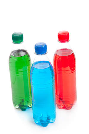 three colored plastic bottle with juice  photo