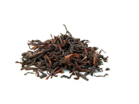 Té suelto secado de hojas de té, aislados  Foto de archivo