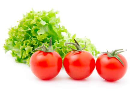 赤いチェリー トマトとレタスのサラダ 写真素材