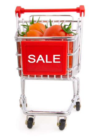 a Shopping cart full of tomatoes on a white background Stock Photo - 10277933