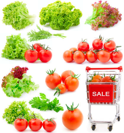 edible leaves: Assortment of red cherry tomatoes and lettuce leaves, isolated on white background