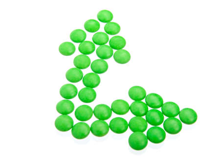 valerian: green tablets in arrow formation, isolated on white background Stock Photo