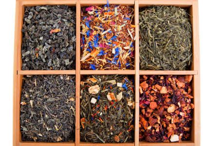 Dry tea collection in wooden box photo