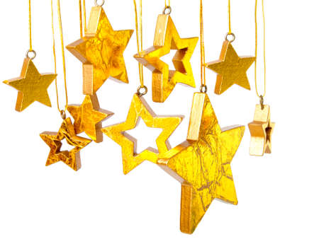 Golden Christmas stars, isolated on white background  Stock Photo - 11003444