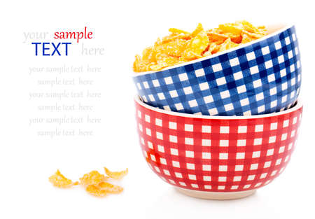 Cornflakes in a porcelain bowl, isolated on white background photo