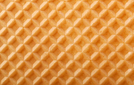 Structure of a baked golden waffle background photo