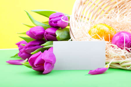 Bouquet of tulips with blank card and Easter eggs photo