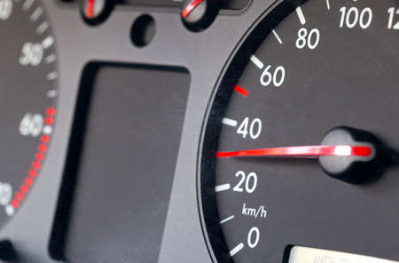 Speedometer of a car showing 30 photo