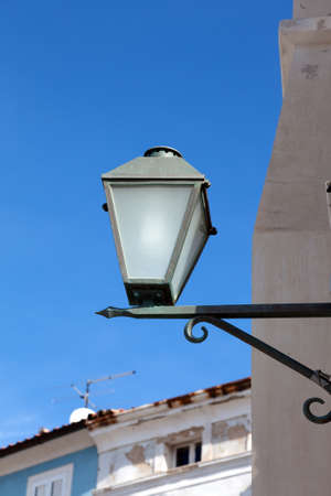 old street-lamp on house background Stock Photo - 13007319