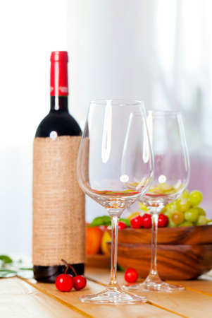 two glass with red wine on wooden table Stock Photo - 13007309