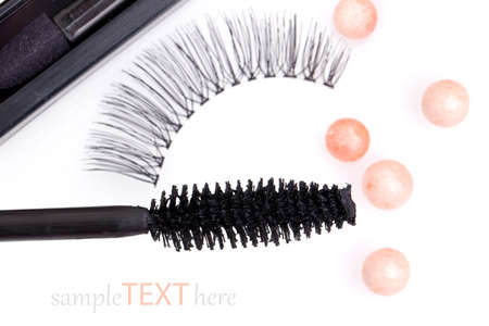 black false eyelashes with mascara and powder, on white background photo