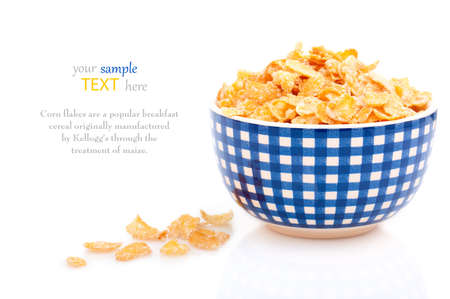 Cornflakes in a porcelain bowl, isolated on white background. with with room for text photo