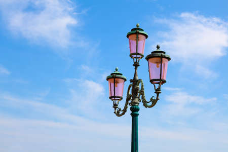 streetlamp: old street-lamp on blue sky Stock Photo