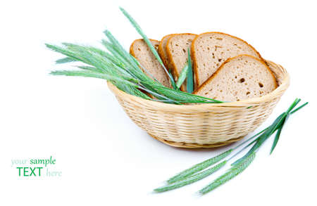 tasty baked bread with ears of wheat, isolated on a white background photo