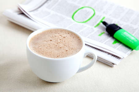 pause button: Morning coffee with newspaper Stock Photo